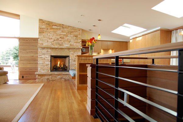 60's Modern Home remodel-living room, kitchen and fireplace.  Open floor plan.