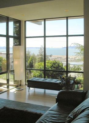 Family Room with floor to ceiling glass overlooking the San Francisco Bay and Golden Gate Bridge