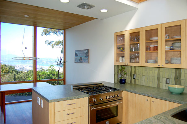 View from kitchen overlooking Sausalito.  New floor to ceiling windows, a rebuilt deck and a kitchen mirror wall emphasize the stunning views stretching from Richardson bay up to nearby Mount Tamalpais.