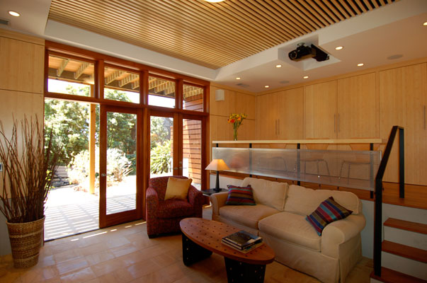 New home theater and family room in Berkeley incorporates warm materials, natural light and a dramatic mezzanine level.  Mahogany French doors open to an outdoor terrace.
