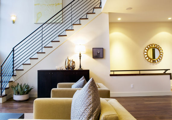 Elegant materials and a double height living room create a dramatic stair.