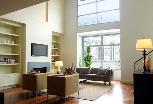 Double height living room with bay and clerestory windows provides abundant natural light.